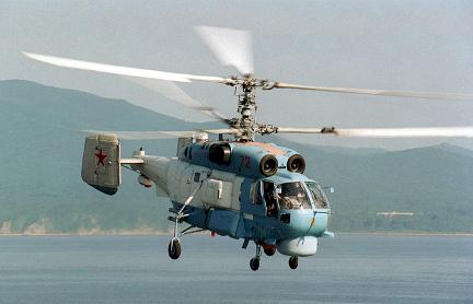 A Russian KA-27SP (Helix D) helicopter flies past the flight deck of USS BELLEAU WOOD (LHA 3) (not shown) to prepare for landing on the amphib ious assault ship during Exercise COOPERATION FROM THE SEA '96, off the coast of Vladivostok, Russia. The landing marks the first time a Russian helicopter has touched down on a US Navy ship as part of this annual exercise.