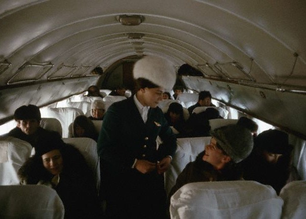 1966, Russia, USSR --- A fur-hatted Aeroflot air stewardess called Tamara. The Iluyshin 14's curved ribs are covered with frost and passengers remained bundled thoughout the flight. --- Image by © Dean Conger/CORBIS