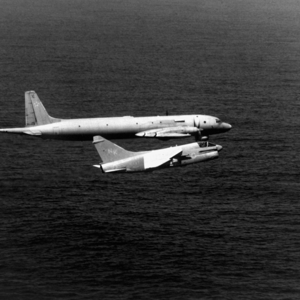 "An air-to-air right side view of a Soviet Il-38 Ilyushin aircraft, NATO designation ""May,"" and a U. S. Navy A-73 Corsair II aircraft from Attack Squadron 27 (VA-27) assigned to Carrier Air Wing 14 (CVW-14). The smaller U.S. Navy aircraft is being piloted by LCDR Dave Park."