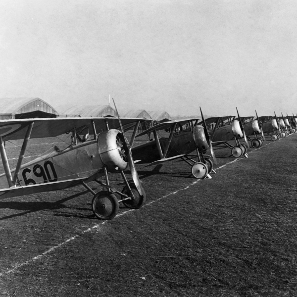 Twenty-six fighter biplanes are lined up for inspection at an airfield in Issoudon, France, April, 1918.
