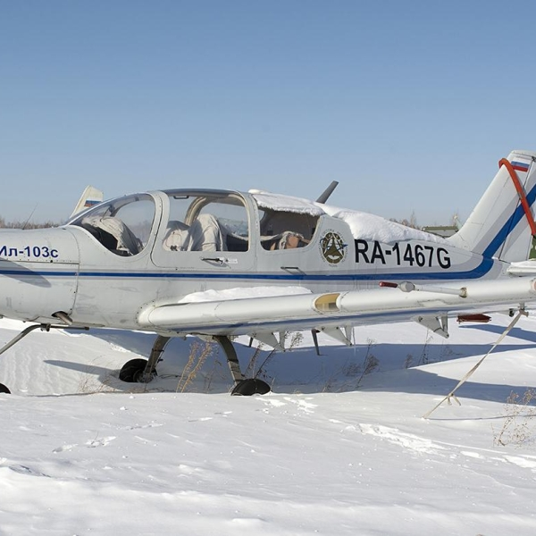 15.Ил-103 на стоянке. Аэродром РОСТО Лесной (Барнаул). Февраль 2015 г.