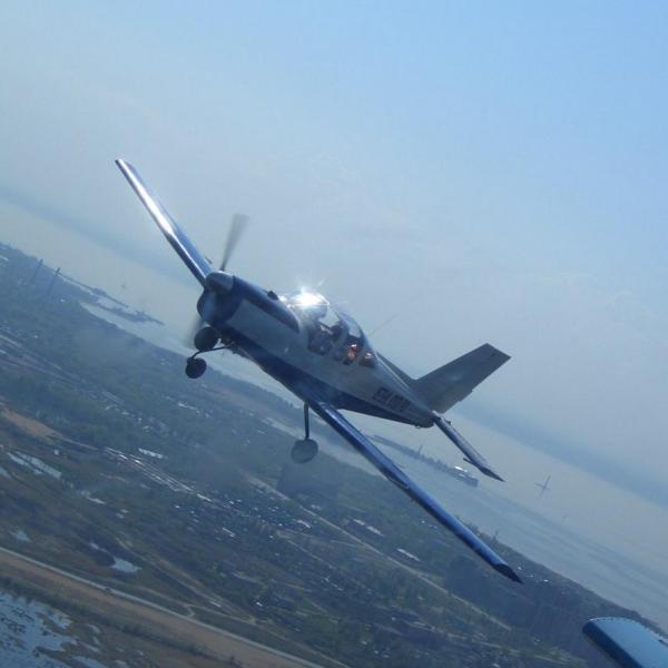 5.Самолет Дельфин-4 в полете.
